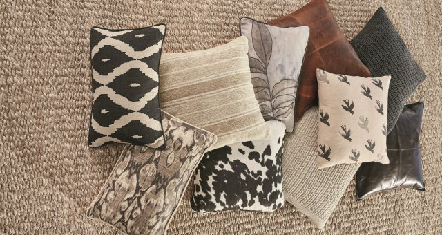 Assorted black, gray and brown pillows.