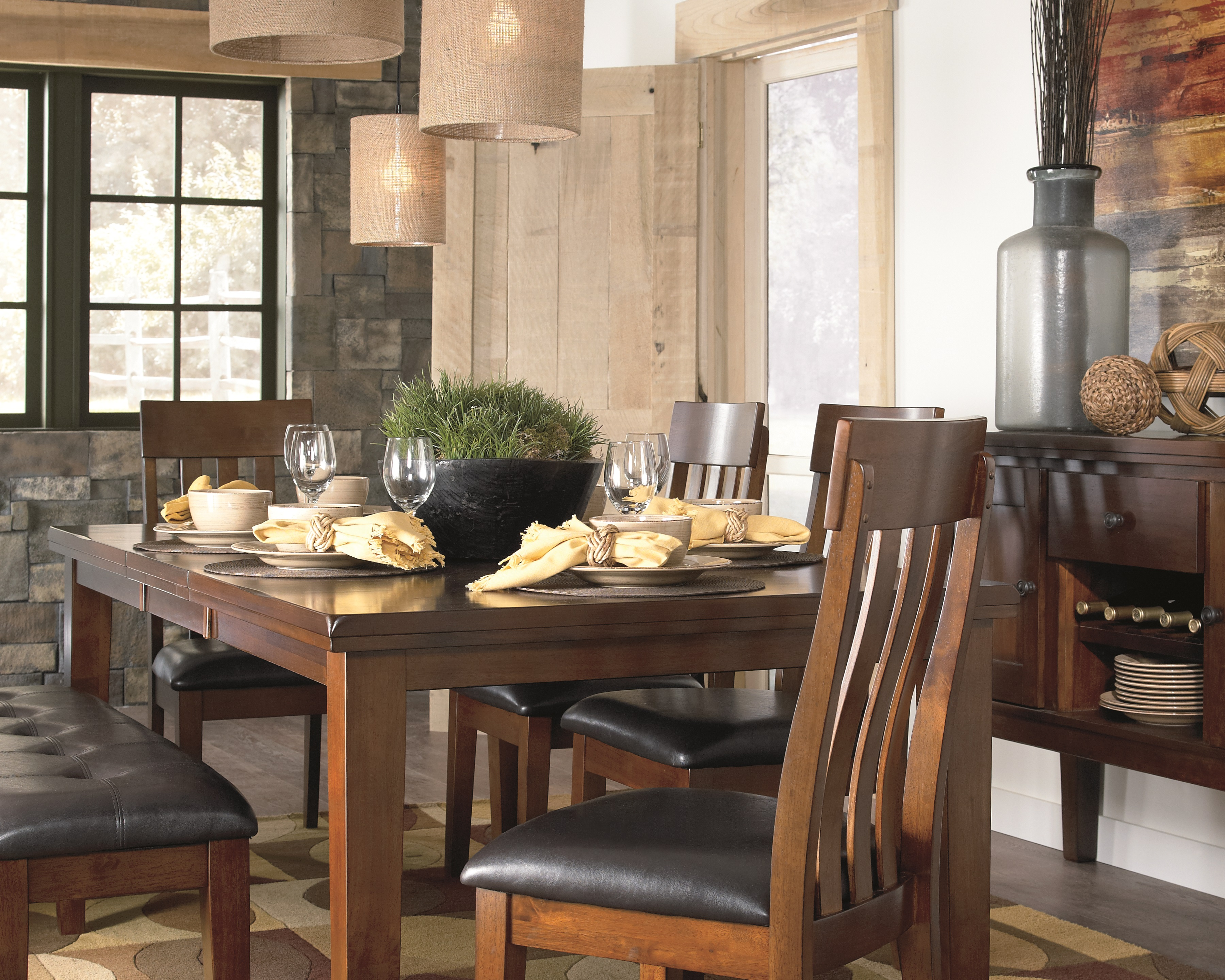 Strumfeld warm brown dining table with upholstered seating and serving table