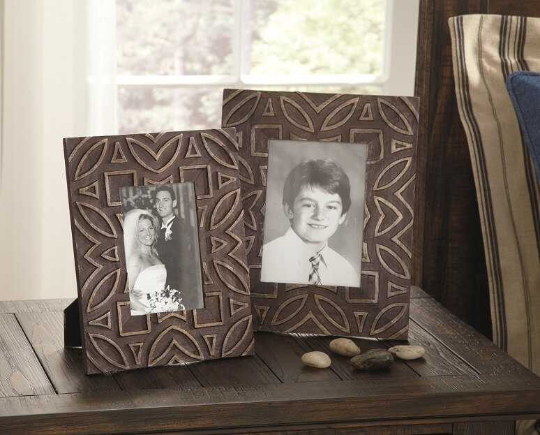raised shapes adorn these antique black photo frames