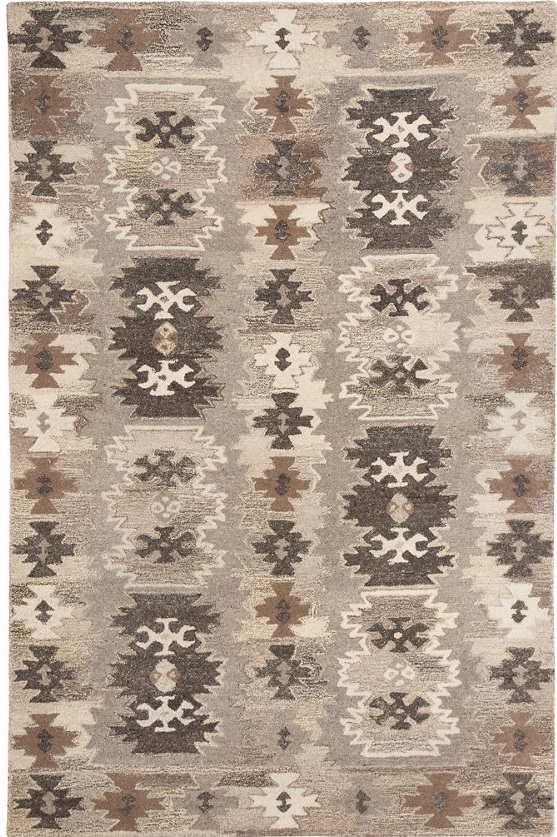 A rustic Moroccan rug with grays and browns in a fun Aztec pattern.