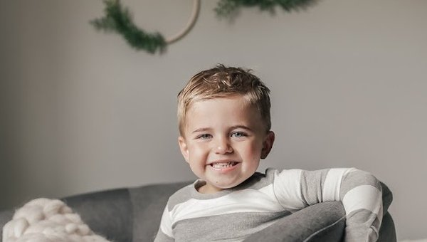 Child smiling in room.