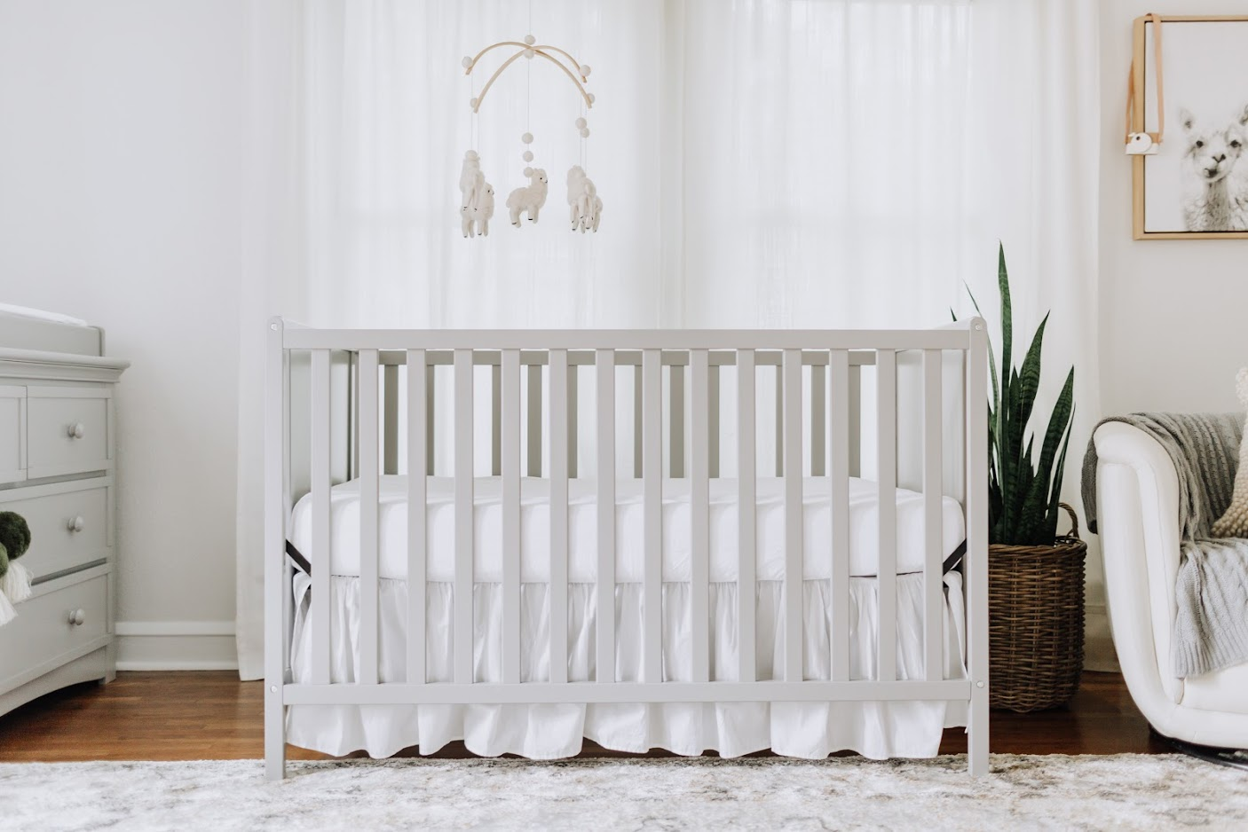 A neutral crib creates a space for a baby's room.